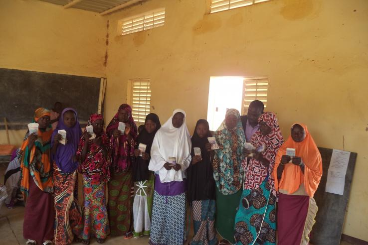 Girls receiving their scholarships in rural Niger