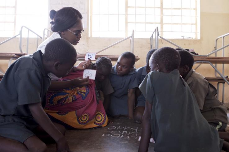 Woman teaching students in Africa