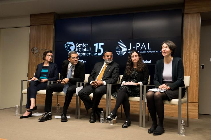 Panel of five speakers at the event