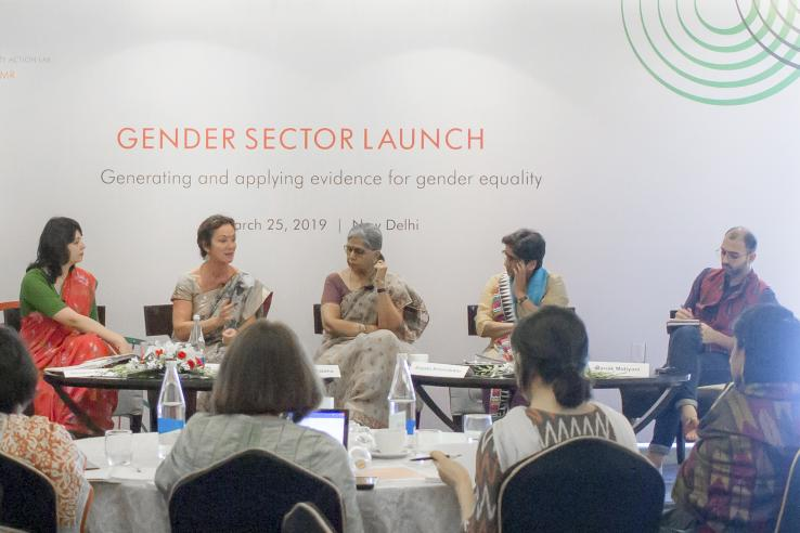 Panelists sit at a table at the Gender Sector launch in New Delhi.