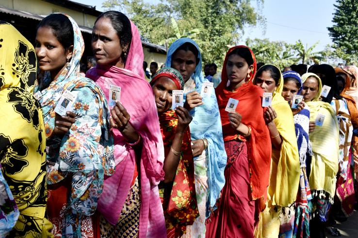 Women stand in line waiting to cast their vote at a polling station in in Barpeta, Assam, India.