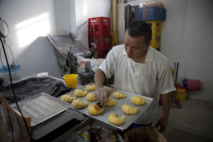 A man baking croissants