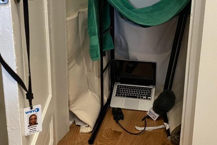 work from home closet studio with laptop on floor and green towel at the top