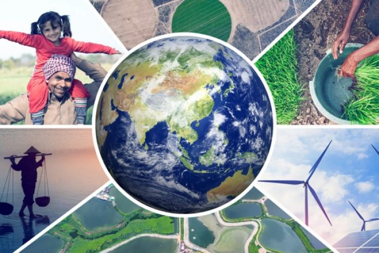 earth surrounded by pictures of windmills, plants, green land, and man carrying child