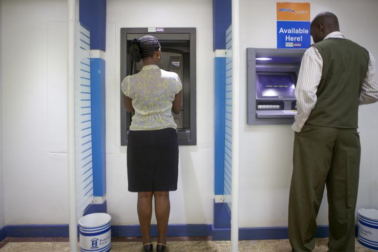 Man and woman at ATMs