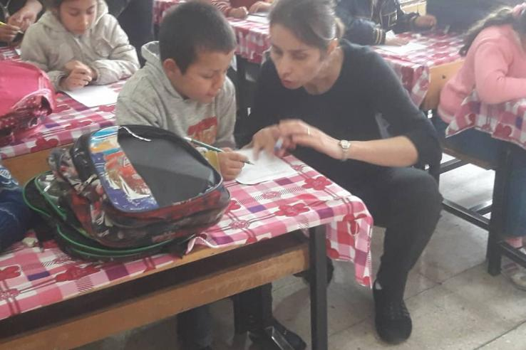 Sule Alan talks to children in a classroom in Turkey.