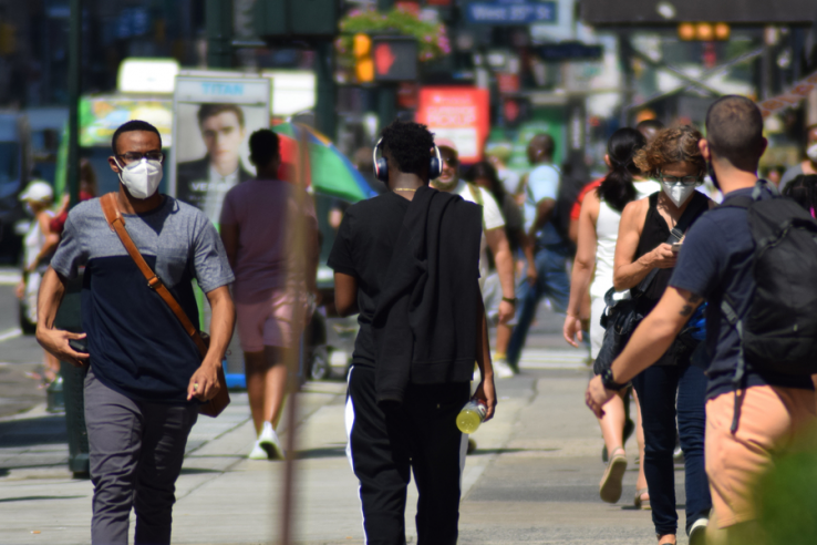 People walking in the street with masks on