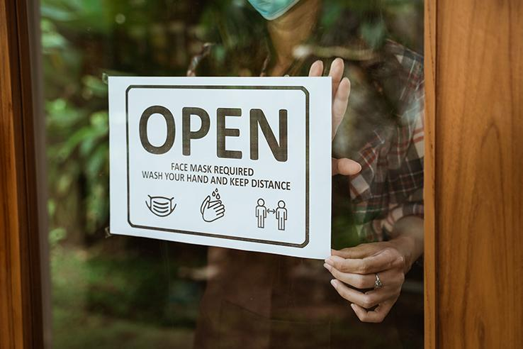 Individual switching business sign to 'open'