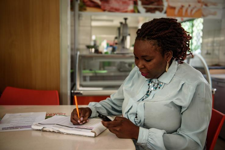 A woman completes a digital cash transfer
