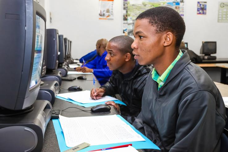 Two South African youths engaging in online skills training