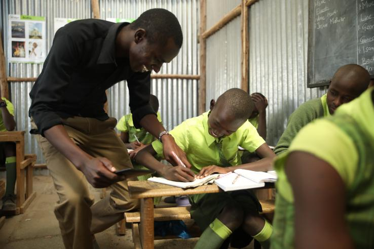 A Bridge Kenya teacher provides feedback during pupil practice.