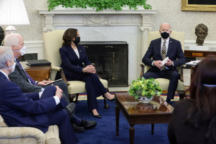 Joe Biden and Kamala Harris wearing masks attending a meeting in the White House