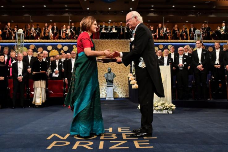 Esther Duflo shakes hands with the King of Sweden as she is awarded the Nobel Memorial Prize in Economic Sciences in 2019.