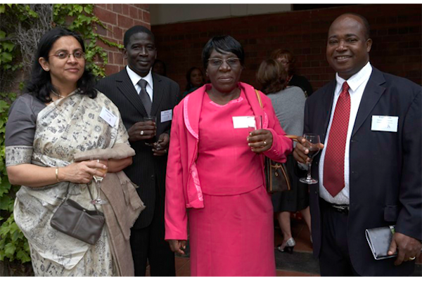 Three people pose for a photo at J-PAL Africa's launch event.