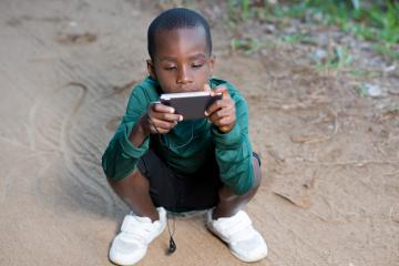 young-boy-using-cell-phone