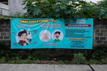 A poster in Indonesia with health recommendations