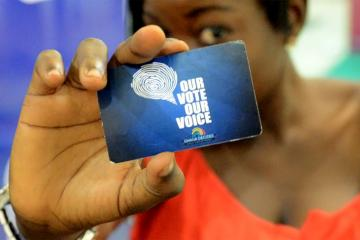 "Woman holds a card that reads ""our vote our choice"" from Ghana Decides"