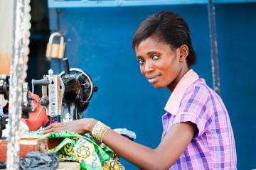 Woman works with a sewing machine in Ghana
