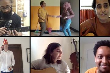 A Zoom screenshot of seven staffers performing on guitars, dancing, juggling, and speaking.
