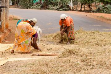 Three women engage in manual labor in India